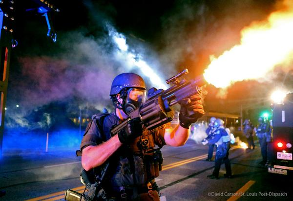 Ferguson Cop firing flashbombs or some goddam thing