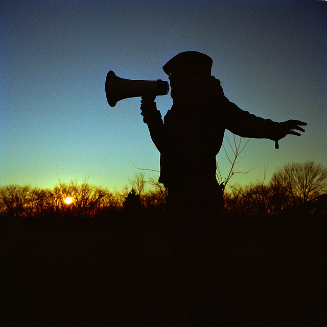 Bullhorn poet speaks to the horizon by lau on Flickr