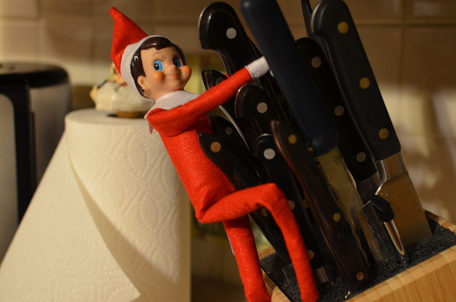 Elf on a Shelf playing with knives