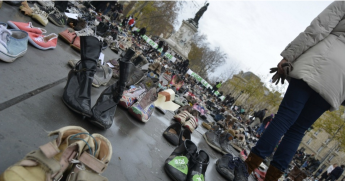 Early Sunday morning, activists with Avaaz set out a sea of donated shoes in the Place de la République, representing the thousands who were outlawed from marching in the streets. (Photo: Joe Solomon)
